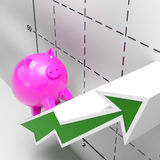Climbing Piggy Shows Growth, Investment And Earnings. Climbing Piggy Showing Growth, Investment Revenue And Earnings Stock Photos