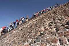Climbing the Pyramid of the Sun at Teotihuacan ancient pre-Columbian site, Mexico Royalty Free Stock Images