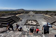 Climbing the pyramid in Teotihuacam, Mexico stock photography