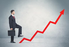 Climbing on red graph arrow Stock Images
