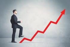 Climbing on red graph arrow Stock Photos
