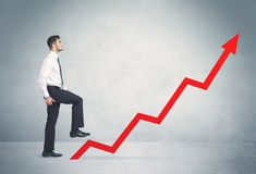 Climbing on red graph arrow Stock Photography