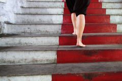 Climbing a red stair Stock Photography