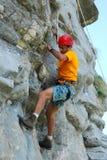 Climbing on rock stock image