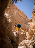 Climbing on a rock Stock Photography