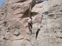 Climbing the Rock Wall. Rock Climbing a 5-10a route in Billings, Montana Royalty Free Stock Photography