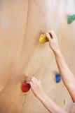 Climbing a Rock Wall Stock Photo