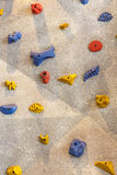 Climbing rock wall Royalty Free Stock Image
