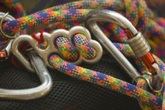 Climbing rope. Mountain rope with brake and karabiner Stock Photos