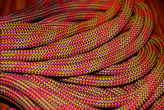 Climbing rope. Close up of a coiled, dynamic climbing rope Royalty Free Stock Images