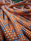 Climbing rope. Close detail with an orange climbing rope Royalty Free Stock Images