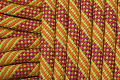 Climbing rope detail. Detail of a new orange, yellow, and red climbing rope Royalty Free Stock Photo