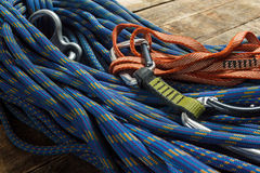 Climbing rope and equipment on wooden boards Stock Photo