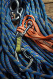 Climbing rope and equipment on wooden boards Stock Image