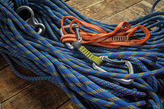 Climbing rope and equipment on wooden boards Stock Photos