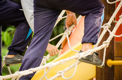 Climbing on rope. Ladder obstacle course equipment stock photo