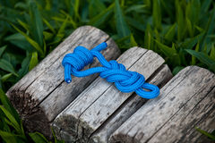 Climbing rope on a natural background. Joined rope ends with double overhand knots Stock Photos