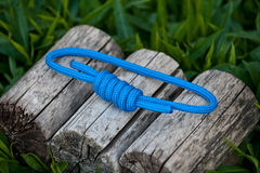 Climbing rope on a natural background. Joined rope ends with double overhand knots Stock Image