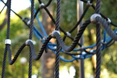 Climbing ropes on a playground. Detail of strong climbing ropes in a playground for kids to climb Royalty Free Stock Photography