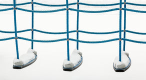 Climbing ropes at a playground in winter. Snowy climbing rope equipment with white background at a playground in winter Stock Photos