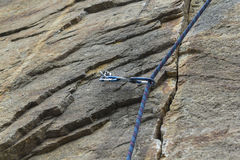 Climbing. A safety bolt threaded a rope with a carbine Stock Images