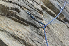 Climbing. A safety bolt threaded a rope with a carbine Stock Image