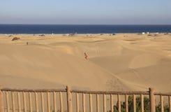 Climbing a sand dune Stock Images