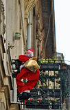 Climbing Santa Claus. Photography of climbing figure of Santa Claus Stock Image