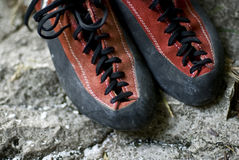 Climbing shoes. Closeup on climbing shoes placed on rocky  surface Stock Photos