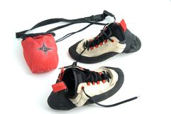 Climbing shoes and the chalk bag. Isolated on white background Stock Photo