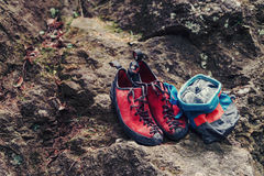 Climbing shoes and sack Stock Photo