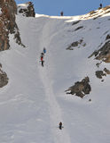 Climbing and skiing Stock Photography