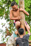 Climbing slippery pole competition or Panjat Pinang indonesian traditinal games Royalty Free Stock Images