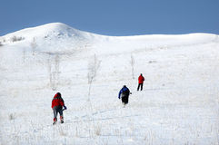 Climbing snow mountain Stock Images
