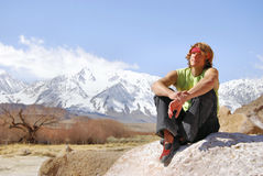 Climbing Solitude. A beautiful scene from Bishop California and the snow covered Sierra Mountains as a climber thinks about his day with an injured hand Stock Image