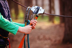 Climbing Sports Image Of A Carabiner On A Metal Rope In A Forest Royalty Free Stock Photography