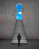 Climbing on stairs with business concept doodles on wall. Climbing on stairs with business concept doodles on concrete wall Stock Photos