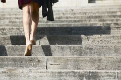 Climbing stairs. Woman with heels while climbing the stairs Stock Photos