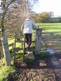 Climbing a Stile. Walking in the English Countryside royalty free stock photography