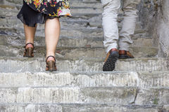 Climbing on stone stairs. A woman and man climbing on stone stairs Royalty Free Stock Photography