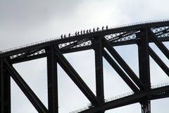 Climbing Sydney harbor bridge. Group of poeple climbing Sydney harbor bridge royalty free stock photography