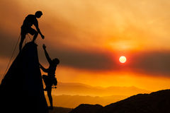 Climbing team on the edge. Royalty Free Stock Images
