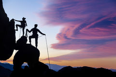 Climbing team on the edge. Stock Images