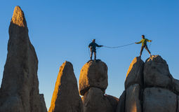 Climbing team struggles to the summit. Royalty Free Stock Photography