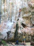 Climbing in thailand. Climber's on a thai limbstone rock-face Stock Image