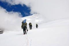 Climbing three climbers on Titnuld. Climbing three climbers on the snowy mountain Titnuld Stock Photo