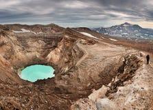 Climbing to active volcano Stock Photo