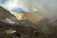 Climbing to active volcano Mutnovsky on Kamchatka. Royalty Free Stock Photography