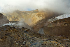 Climbing to active volcano Mutnovsky on Kamchatka. Stock Photos