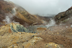 Climbing to active volcano Mutnovsky on Kamchatka. Royalty Free Stock Images